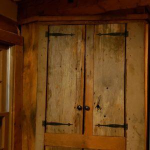 Reclaimed lumber corner cabinet