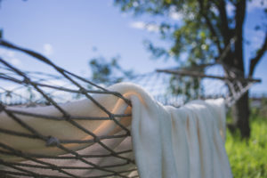 towel draped over a hammock outdoors