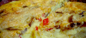 Frittata close up picture with mushrooms and red bell pepper