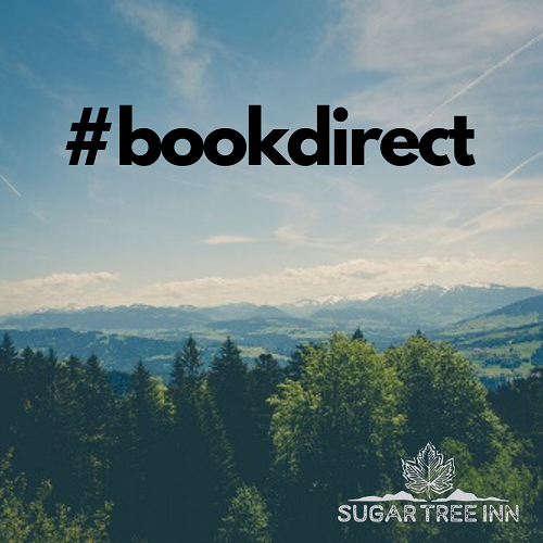 Mountain landscape with #bookdirect text overlay