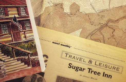 Sepia colored map of the Blue Ridge Mountains with Travel & Leisure section of newspaper featuring Sugar Tree Inn and watercolor of the inn with an american flag out front.