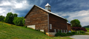 Wood siding barn in hillside