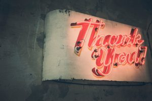 vintage white neon sign with red cursive thank you lettering